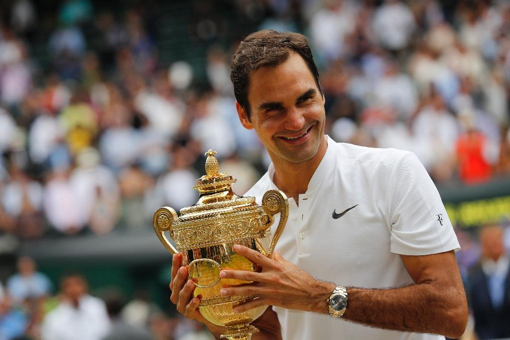 King of Wimbledon: Roger Federer after winning Wimbledon for a record eighth time in 2017 (AFP Photo/Adrian DENNIS)
