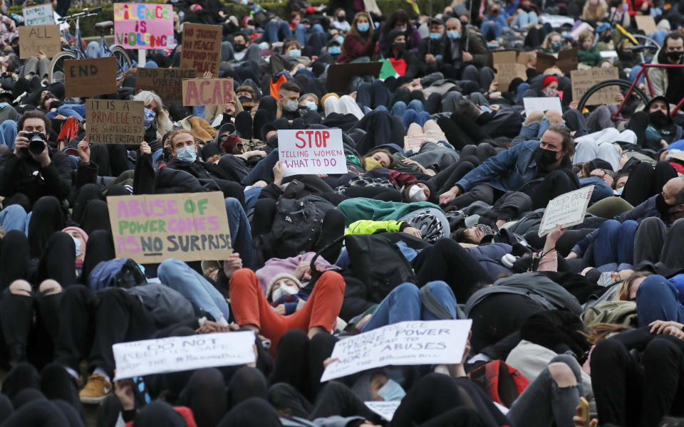 Demonstrators lay-down in Parliament Square in London, Sunday, March 14, 2021 during a protest over the abduction and murder of Sarah Everard and the subsequent handling by the police of a vigil honoring the victim. London's Metropolitan Police force was under heavy pressure Sunday to explain its actions during a vigil for Sarah Everard whom one of the force's own officers is accused of murdering. (AP Photo/Frank Augstein)