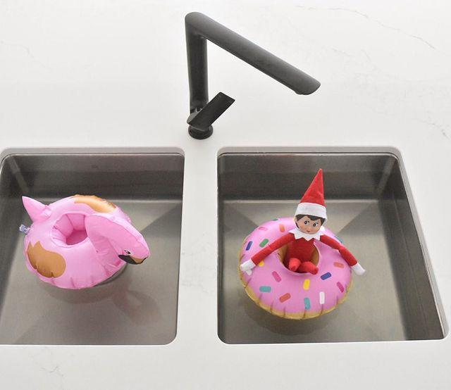 """<p>Since your Elf is only a few inches tall, a kitchen sink works perfectly as a swimming pool. Add a few adorable """"pool floats"""" (in this case, mini drink holders), and he'll be ready for a splashing good time.</p><p><a class=""""link rapid-noclick-resp"""" href=""""https://go.redirectingat.com?id=74968X1596630&url=https%3A%2F%2Fwww.walmart.com%2Fip%2FGoFloats-Inflatable-Floatmingo-Drink-Holder-3-Pack-Float-your-drinks-in-style%2F54267589&sref=https%3A%2F%2Fwww.thepioneerwoman.com%2Fholidays-celebrations%2Fg34080491%2Ffunny-elf-on-the-shelf-ideas%2F"""" rel=""""nofollow noopener"""" target=""""_blank"""" data-ylk=""""slk:SHOP DRINK HOLDERS"""">SHOP DRINK HOLDERS</a></p><p><a href=""""https://www.instagram.com/p/Bcshjxglw60/"""" rel=""""nofollow noopener"""" target=""""_blank"""" data-ylk=""""slk:See the original post on Instagram"""" class=""""link rapid-noclick-resp"""">See the original post on Instagram</a></p>"""
