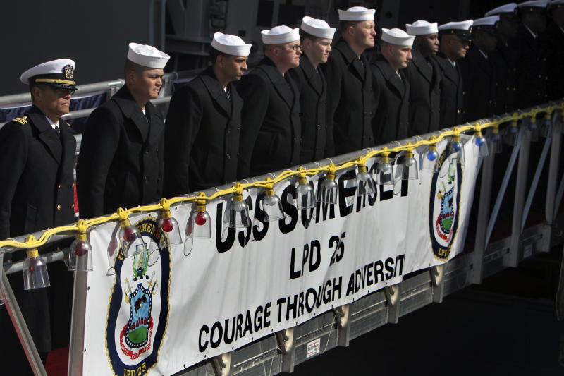 Crew members line the gangplank during a commissioning ceremony for the USS Somerset (LPD 25) Saturday, March 1, 2014, in Philadelphia. The USS Somerset is the ninth San Antonio-class amphibious transport dock and the third of three ships named in honor of those victims and first responders of the attacks on the World Trade Center and the Pentagon. The ship is named for the county where Flight 93 crashed after being hijacked on Sept. 11, 2001. (AP Photo/ Joseph Kaczmarek)