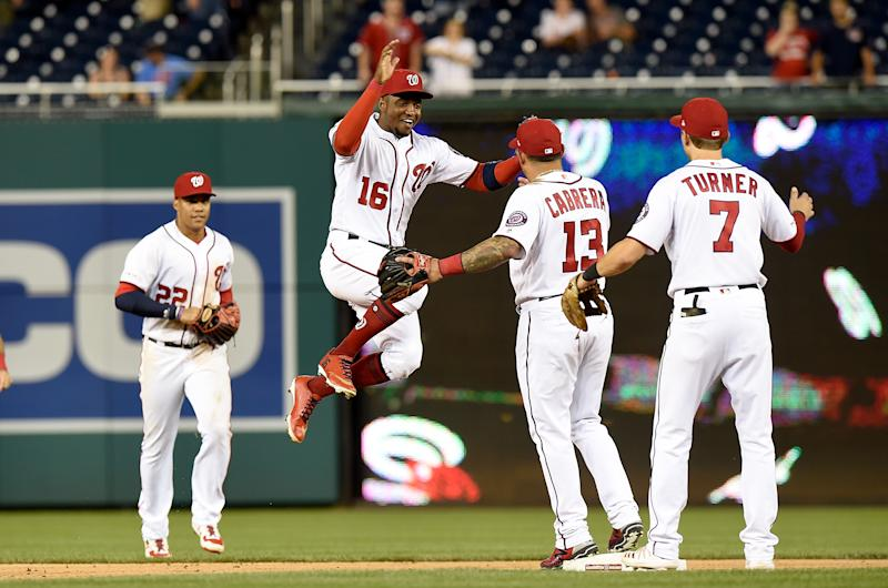 WASHINGTON, DC - SEPTEMBER 23: Victor Robles #16 of the Washington Nationals celebrates with teammates after a 7-2 victory against the Philadelphia Phillies at Nationals Park on September 23, 2019 in Washington, DC. (Photo by Greg Fiume/Getty Images)