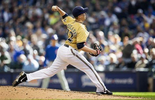 Milwaukee Brewers' Tom Gorzelanny pitches to a Chicago Cubs batter during the eighth inning of an MLB National League baseball game Sunday, April 21, 2013, in Milwaukee. (AP Photo/Tom Lynn)