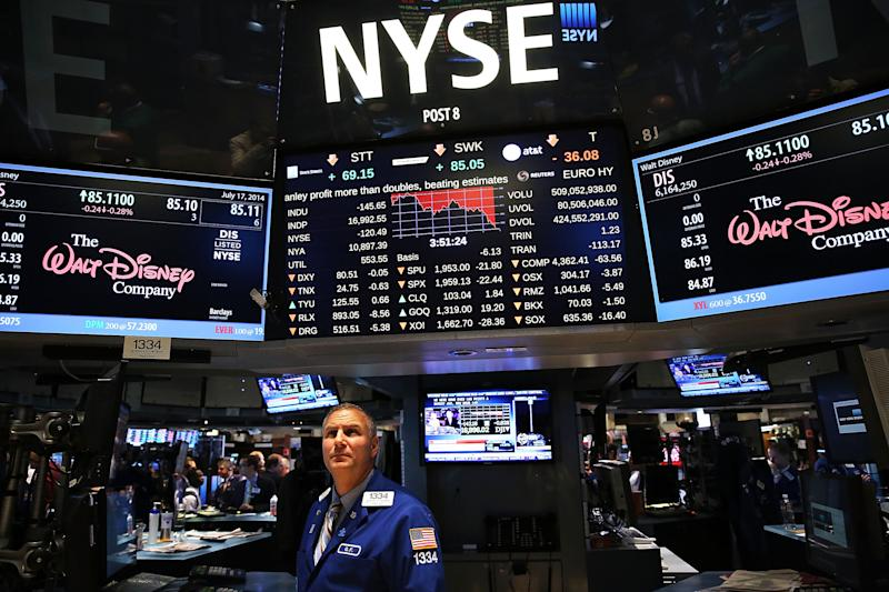Traders work on the floor of the New York Stock Exchange on July 17, 2014