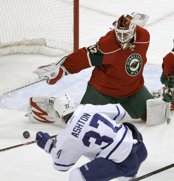 Minnesota Wild goalie Niklas Backstrom (32), of Finland, stops a shot by Toronto Maple Leafs right wing Carter Ashton (37) during the first period of an NHL hockey game in St. Paul, Minn., Wednesday, Nov. 13, 2013. (AP Photo/Ann Heisenfelt)