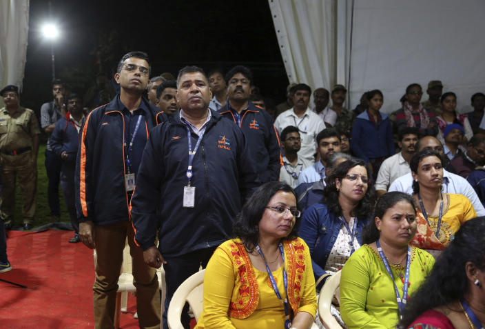 Indian Space Research Organization (ISRO) employees react as they listen to an announcement by organizations's chief Kailasavadivoo Sivan at its Telemetry, Tracking and Command Network facility in Bangalore, India, Saturday, Sept. 7, 2019. India's space agency said it lost touch Saturday with its Vikram lunar lander as it aimed to land on the south pole of the moon and deploy a rover to search for signs of water. (AP Photo/Aijaz Rahi)