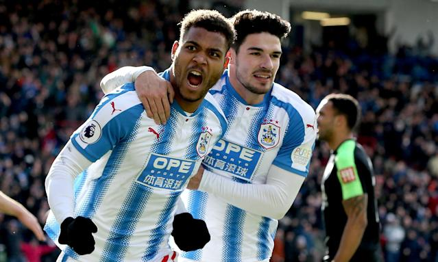 Steve Mounié celebrates with his team-mate Christopher Schindler after scoring Huddersfield's second goal in their 4-1 win against Bournemouth at the John Smith's Stadium.
