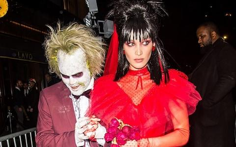 Model Bella Hadid and singer The Weeknd are seen leaving Heidi Klum's 19th Annual Halloween Party at Lavo NYC on October 31, 2018