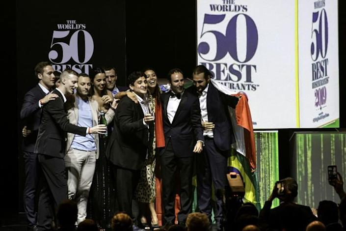 The French-based Argentinian chef Mauro Colagreci (centre) comes out top at the awards ceremony for the world's 50 Best Restaurants ranking in Singapore last year (AFP Photo/Theodore LIM)