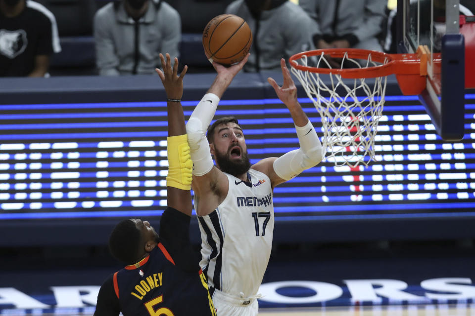 Memphis Grizzlies' Jonas Valanciunas (17) shoots against the Golden State Warriors' Kevon Looney (5) during the second half of an NBA basketball Western Conference play-in game in San Francisco, Friday, May 21, 2021. (AP Photo/Jed Jacobsohn)