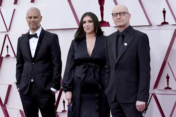 Jesse Collins, from left, Stacey Sher, and Steven Soderbergh arrive at the Oscars on Sunday, April 25, 2021, at Union Station in Los Angeles. (AP Photo/Chris Pizzello, Pool)