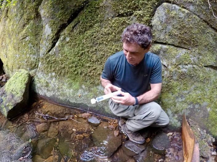 Tony Goldberg, a researcher at the University of Wisconsin-Madison, does lab work in the field in Sierra Leone.
