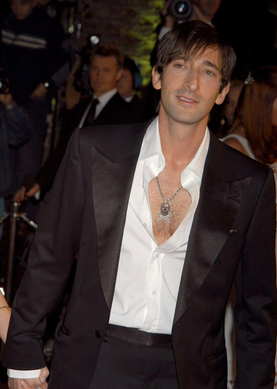 <p>The Oscar-winning actor wore a white silk shirt under a sport coat in 2005 and paired his chest hair with a skull necklace, naturally.</p>
