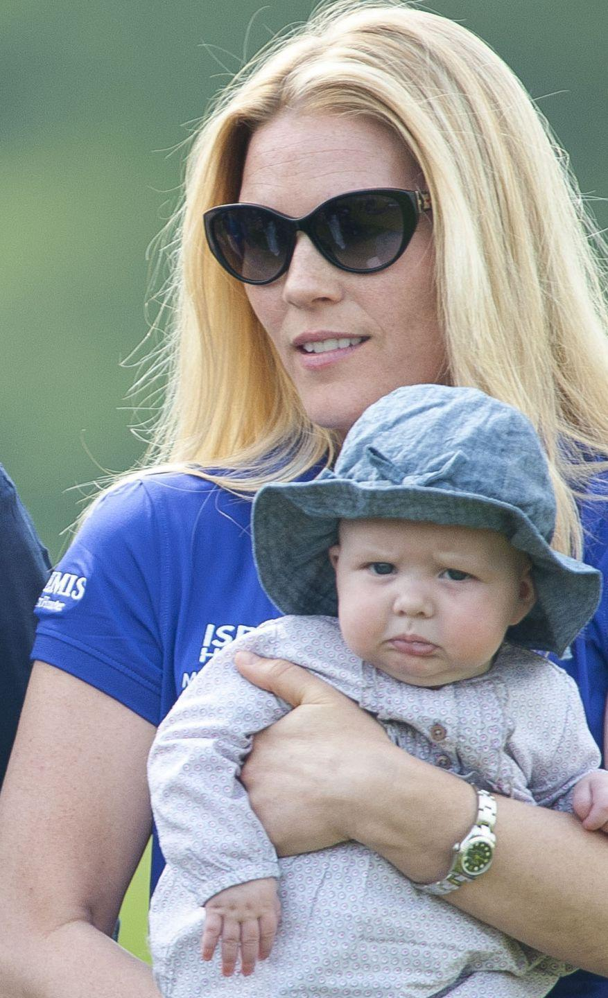 <p>Mia Tindall is held by mom Zara Phillips' sister-in-law, Autumn Phillips, during the Mike Tindall Celebrity Golf Classic at the Celtic Manor Resort of Newport, Wales in May 2014. Just look at that little pouty face!</p>