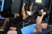 A group lift weights in a fitness class at Lift Society Friday, May 21, 2021, in Studio City, Calif. California's top health official says the state no longer will require social distancing and will allow full capacity for businesses when the state reopens on June 15. (AP Photo/Marcio Jose Sanchez)
