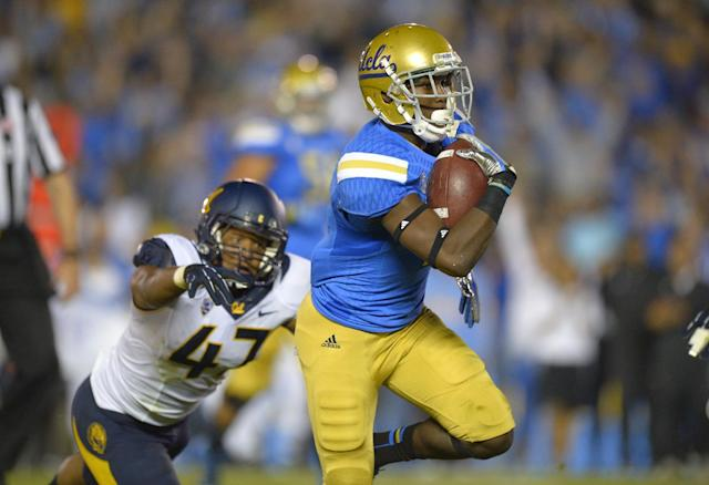 UCLA wide receiver Devin Fuller, right, runs in for a touchdown as California linebacker Hardy Nickerson tries to tackle him during the first half of their NCAA college football game, Saturday, Oct. 12, 2013, in Pasadena, Calif. (AP Photo/Mark J. Terrill)