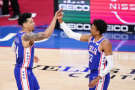 Philadelphia 76ers' Danny Green, left, and Matisse Thybulle celebrate during the first half of an NBA basketball game against the Sacramento Kings, Saturday, March 20, 2021, in Philadelphia. (AP Photo/Matt Slocum)