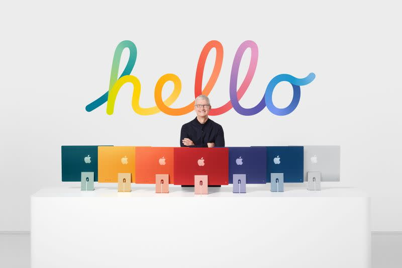 Apple CEO Tim Cook with the all-new iMac lineup in Cupertino