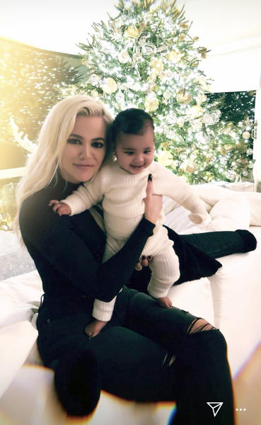 Khloé Kardashian Shows Off Abs While Kissing Baby True