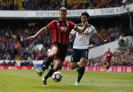 Britain Soccer Football - Tottenham Hotspur v AFC Bournemouth - Premier League - White Hart Lane - 15/4/17 Bournemouth's Simon Francis in action with Tottenham's Son Heung-min Action Images via Reuters / Paul Childs Livepic