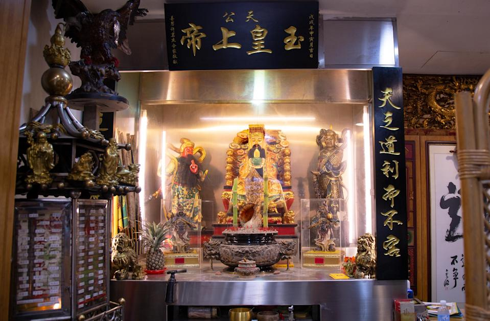 The Jade Emperor sits at the centre of the altar at Chew's shop. (PHOTO: Dhany Osman/Yahoo News Singapore)