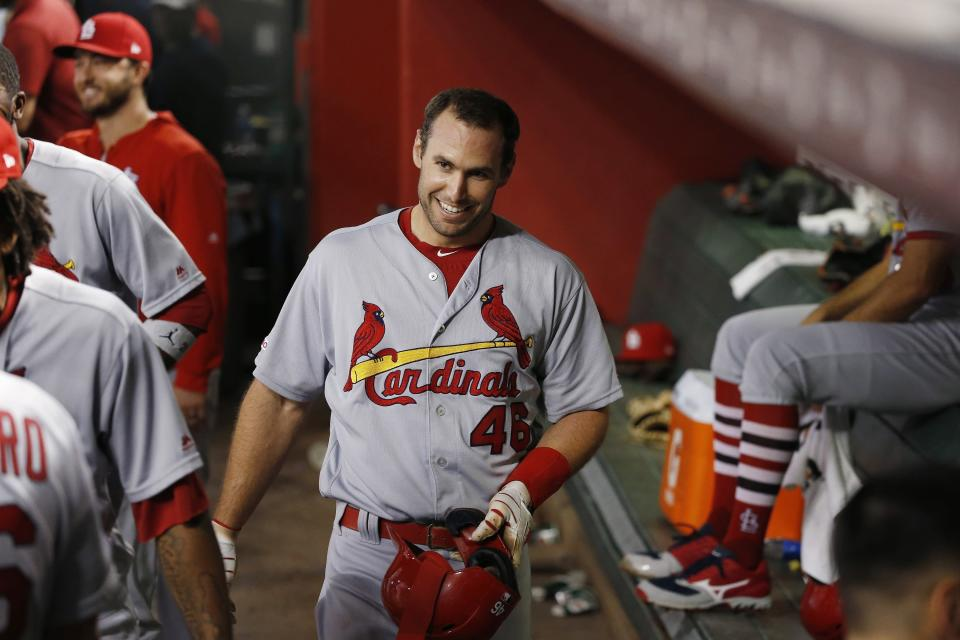 St. Louis Cardinals' Paul Goldschmidt smiles in the dugout after hitting a two-run home run against the Arizona Diamondbacks during the third inning of a baseball game Monday, Sept. 23, 2019, in Phoenix. (AP Photo/Ross D. Franklin)