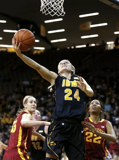 Iowa uard Jaime Printy (24) puts up a shot in front of Iowa State center Anna Prins (55) and forward Brynn Williamson (22) during the first half an NCAA college basketball game Thursday, Dec. 6, 2012 at Carver-Hawkeye Arena in Iowa City, Iowa. (AP Photo/The Gazette,Brian Ray)