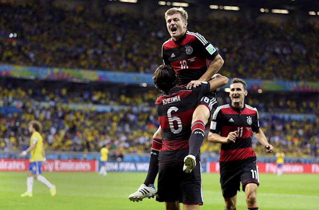 Germany's Toni Kroos celebrates with Sami Khedira (6) and Miroslav Klose (11) after scoring his side's fourth goal during the World Cup semifinal soccer match between Brazil and Germany at the Mineirao Stadium in Belo Horizonte, Brazil, Tuesday, July 8, 2014. (AP Photo/Natacha Pisarenko)