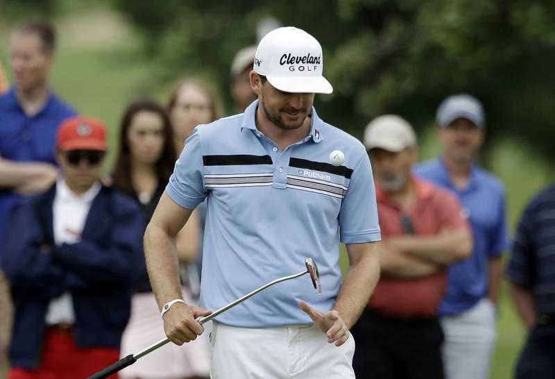 Keegan Bradley bounces his ball off his club as he waits his turn to putt on the second green during the first round of the Byron Nelson Championship golf tournament Thursday, May 16, 2013, in Irving, Texas. Bradley set the TPC Four Seasons course record with a 10-under par 60 in the opening round. (AP Photo/Tony Gutierrez)