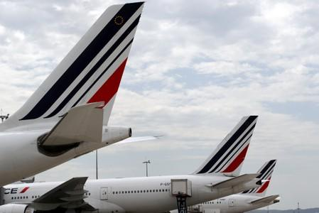 FILE PHOTO: Air France planes are parked on the tarmac at the Paris Charles de Gaulle airport in Roissy
