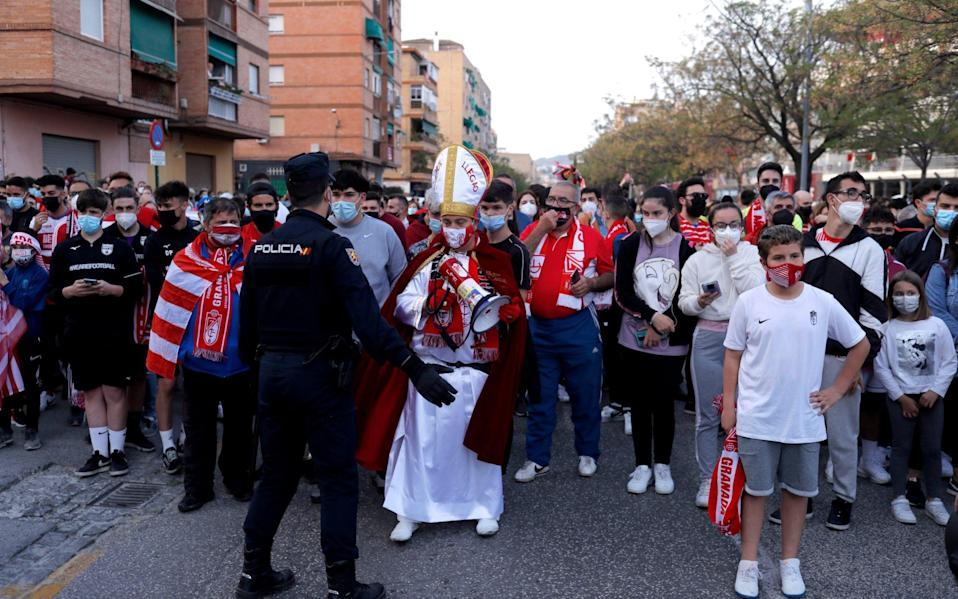 Fans are seen outside the stadium before the match - REUTERS