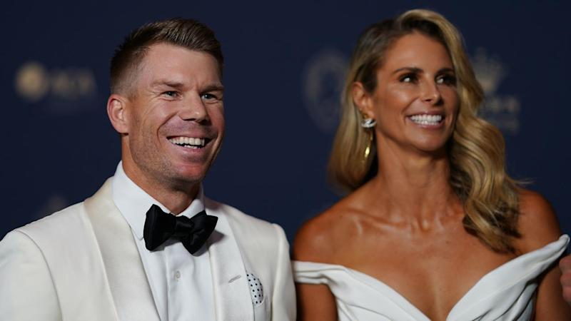 David Warner, pictured with wife Candice Warner, has won the 2020 Allan Border Medal