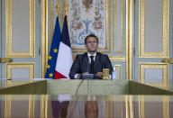 FILE - In this April 22, 2021 file photo, French President Emmanuel Macron attends a Climate Summit video conference, at the Elysee Palace, in Paris,With a year to go to the presidential vote, French President Emmanuel Macron is getting ready for a potential re-election bid by prioritizing reviving the economy and saving jobs. The country is slowly stepping out of its partial lockdown. Macron's ability to meet the challenge will be key _ as France is among countries worst hit by the pandemic in the world, with over 105,000 virus-related deaths. (Ian Langsdon/ Pool photo via AP, File)