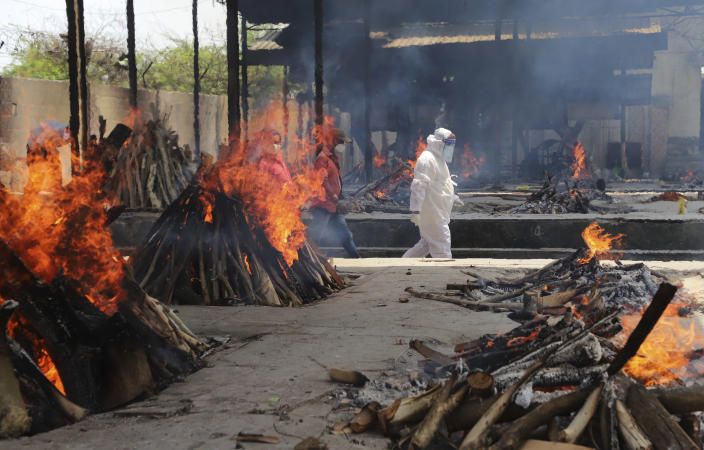 Multiple funeral pyres of people who died of COVID-19 burn at the Ghazipur crematorium in New Delhi, India, Thursday, May 13, 2021. (AP Photo/Amit Sharma)