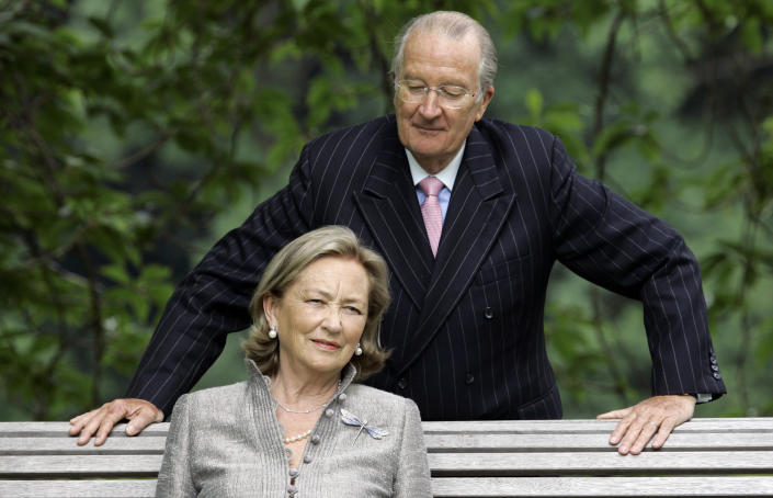FILE - In this Tuesday, July 17, 2008 file photo, Belgium's Queen Paola and King Albert II pose for photographers at the Royal Palace in Laeken, Belgium. Belgium's royal scandal that has riveted the nation and damaged those involved reached a new milestone when former King Albert II reunited with the daughter he fathered out of wedlock over half a century ago. Capping a momentous few weeks, Albert II, and his wife Queen Paola met the former Delphine Boel, who is now recognized as Her Royal Highness Princess Delphine after a bitter two-decade paternity fight. (AP Photo/Virginia Mayo, File)