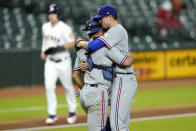 Texas Rangers starting pitcher Kyle Gibson, right, hugs catcher Jeff Mathis after a baseball game against the Houston Astros Wednesday, Sept. 16, 2020, in Houston. The Rangers won 1-0. (AP Photo/David J. Phillip)