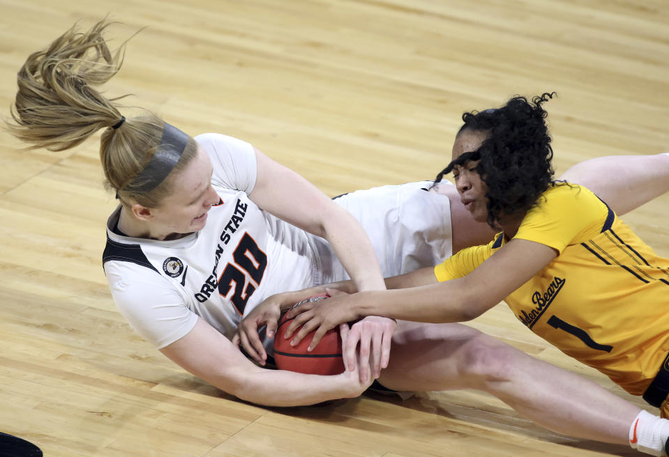 Oregon State forward Ellie Mack (20) and California guard Leilani McIntosh (1) reach for a loose ball during an NCAA college basketball game in the first round of the Pac-12 women's tournament Wednesday, March 3, 2021, in Las Vegas. (AP Photo/Isaac Brekken)