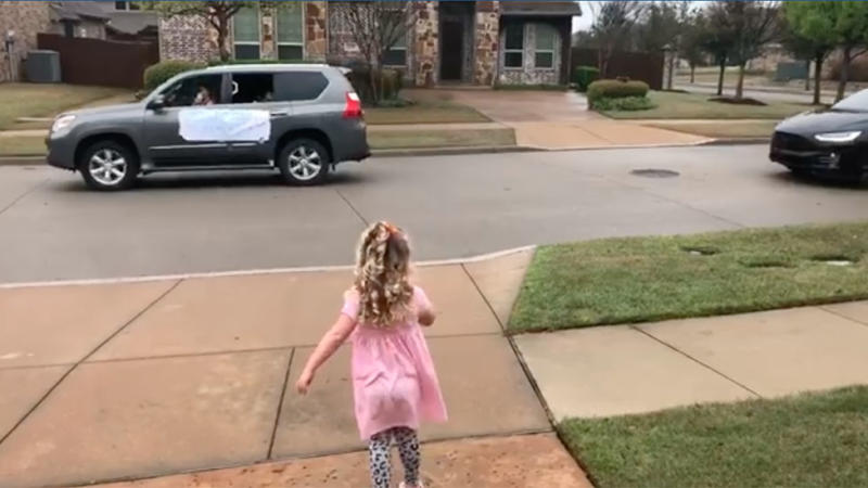 Little girl runs up driveway as cars drive past to wish happy birthday in coronavirus pandemic