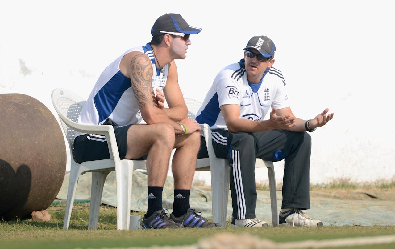AHMEDABAD, INDIA - NOVEMBER 09:  England coach Andy Flower speaks with Kevin Pietersen during day two of the tour match between England and Haryana at Sardar Patel Stadium ground B on November 9, 2012 in Ahmedabad, India.  (Photo by Gareth Copley/Getty Images)