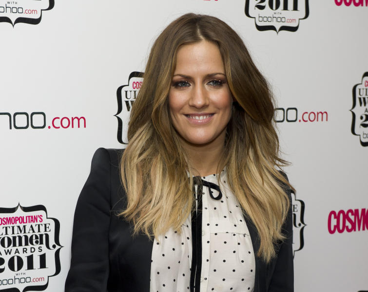 """FILE - In this file photo dated Thursday, Nov. 3, 2011, British TV personality Caroline Flack arrives for the Cosmopolitan Ultimate Women of the Year Awards in London.  The host controversial reality TV show """"Love Island,"""" has died aged 40, according to a statement from her family Saturday Feb. 15, 2020. (AP Photo/Jonathan Short, FILE)"""