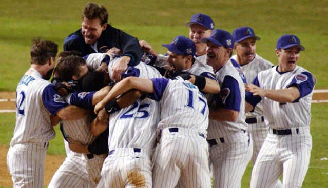FILE - In this Nov. 4, 2001, file photo, the Arizona Diamondbacks celebrate their ninth-inning victory over the New York Yankees in Game 7 of the World Series in Phoenix. The Diamondbacks won the 2001 World Series in their fourth year of existence. (AP Photo/Joe Cavaretta, File)