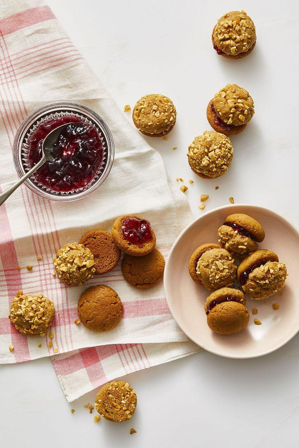 """<p>Serve up these poppable peanut butter cookies spread with grape jam as an after school snack or, even better, a sweet spring dessert.</p><p><em><a href=""""https://www.womansday.com/food-recipes/food-drinks/a28797240/grape-jamwiches-recipe/"""" rel=""""nofollow noopener"""" target=""""_blank"""" data-ylk=""""slk:Get the recipe from Woman's Day »"""" class=""""link rapid-noclick-resp"""">Get the recipe from Woman's Day »</a></em></p>"""