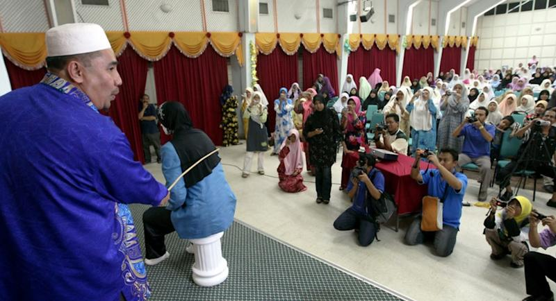 Women caned in Malaysia for attempting to have lesbian sex
