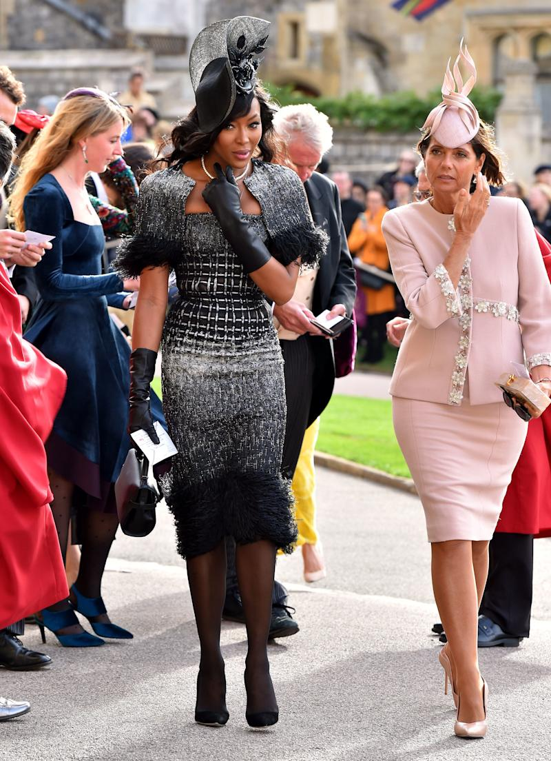 Naomi Campbell and Debbie von Bismarck arrive ahead of the wedding of Princess Eugenie of York to Jack Brooksbank at Windsor Castle on October 12, 2018, in Windsor, England.
