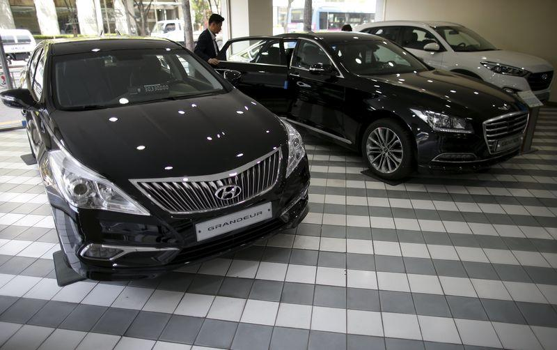 Visitors look at a Genesis' new model EQ900 at its dealership in Seoul