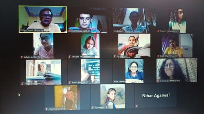 Students attend a class on Zoom
