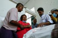 Relatives of U Khin Maung Latt, a NLD's ward chairman react as they receive his dead body in Yangon