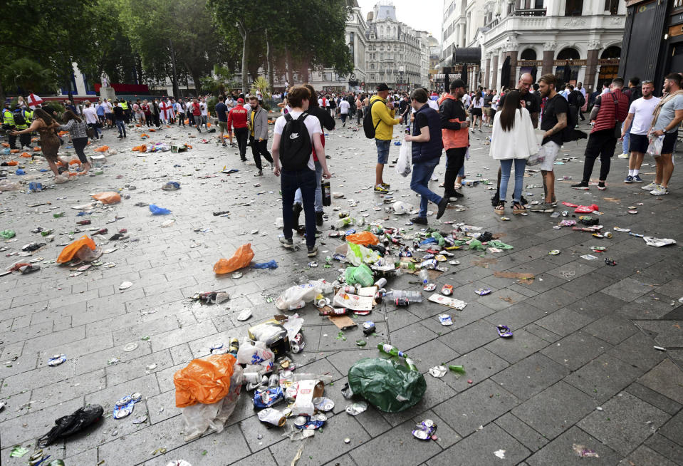 Rubbish left in the wake of fans gathered in Leicester Square central London, Sunday July 11, 2021, ahead of the Euro 2020 soccer championship final match between England and Italy, at Wembley Stadium, in London. (Ian West/PA via AP)