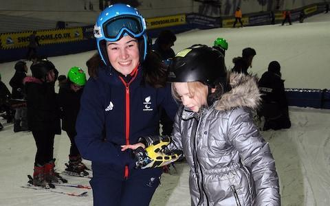 <span>Winter Paralympic champion Menna Fitzpatrick helps a young skier</span> <span>Credit: snowsport england </span>