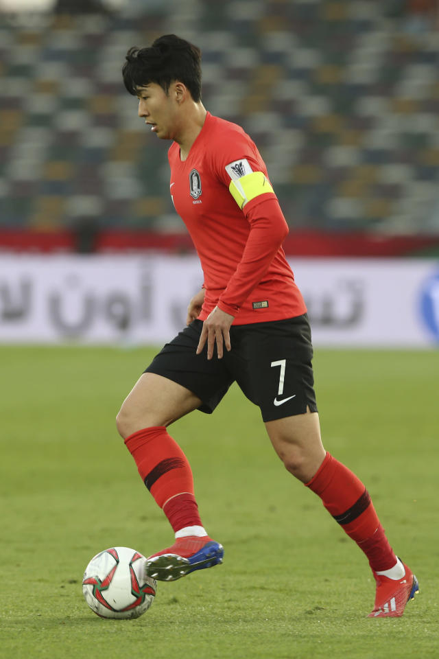 South Korea's forward Son Heung-Min runs with the ball during the AFC Asian Cup quarterfinal soccer match between Korea Republic and Qatar at the Zayed Sport City Stadium in Abu Dhabi, United Arab Emirates, Friday, Jan. 25, 2019. (AP Photo/Kamran Jebreili)