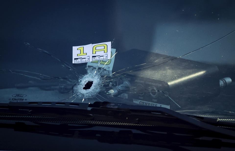 A bullet hole is seen in the windshield of an RCMP vehicle approximately 4 km from Vancouver International Airport after a one person was killed during a shooting outside the international departures terminal at the airport, in Richmond, British Columbia, Sunday, May 9, 2021. (Darryl Dyck/The Canadian Press via AP)